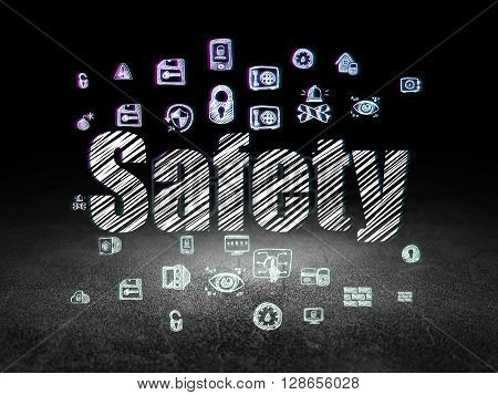 Security concept: Glowing text Safety,  Hand Drawn Security Icons in grunge dark room with Dirty Floor, black background