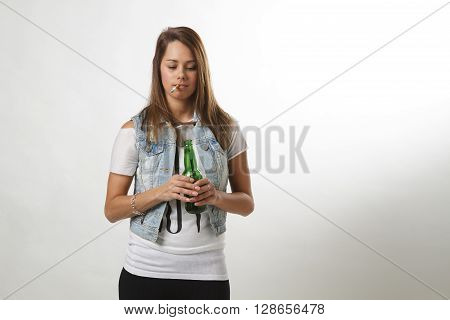 teen girl smoking and drinking against white background