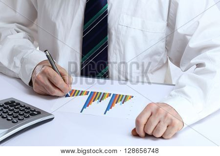 office worker is writing on a document