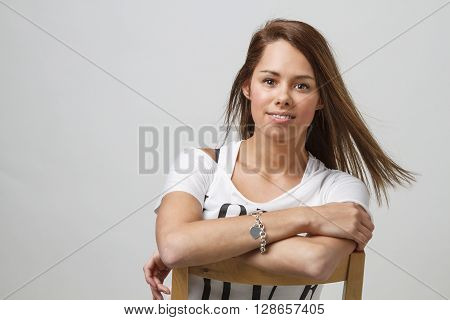Cute Girl Sitting On Chair