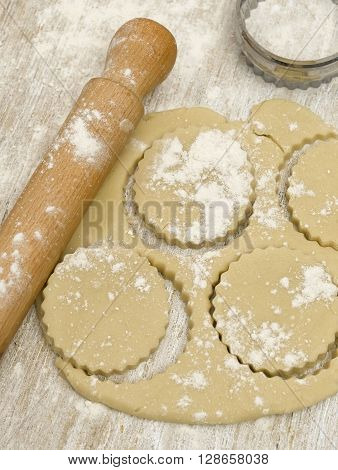 Rolling pin with pastry and cutter no a tabletop