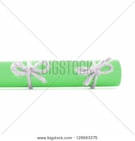 Natural handmade cord knots tied on green paper roll isolated