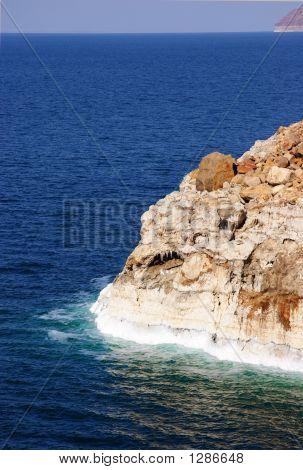 Dead Sea With Salt Caked On Rocks