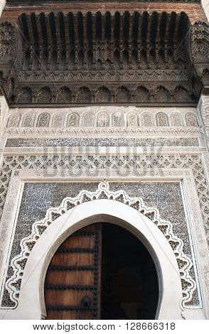Horseshoe Arch decorated with Arabic Mosaic and Moroccan Arabesque Carvings at the Medieval Medina of Fes al Bali, Morocco