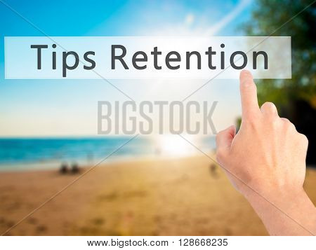 Tips Retention - Hand Pressing A Button On Blurred Background Concept On Visual Screen.