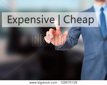 Expensive  Cheap - Businessman Hand Pressing Button On Touch Screen Interface.