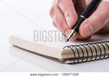 Man Writing A Note With Black Ball Pen In His Hand, Isolated