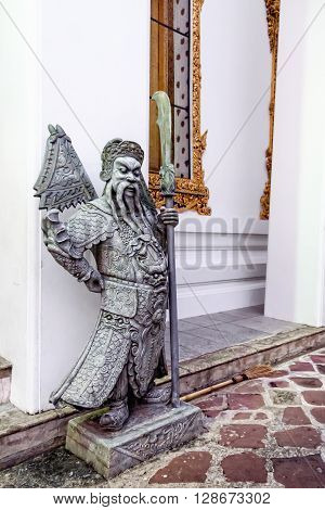Sculpture of Chinese-style guardian in Wat Pho Temple Bangkok Thailand.