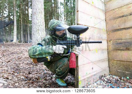 Saint-Petersburg, Russia - April 24, 2016: Paintball tournament in Snaker club between student teams from five universities. Shooter.