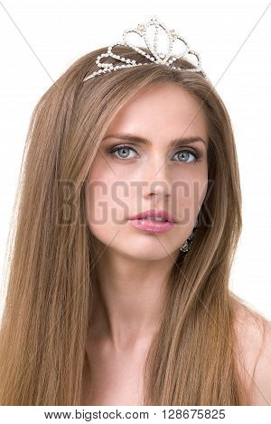 Close up portrait of beautiful girl with diadem, isolated on white background
