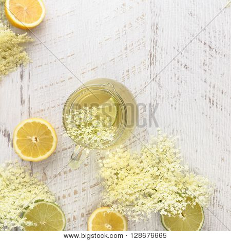 Elderflower syrup. Homemade elder flower syrup with a slice of lemon. Top view with copyspace