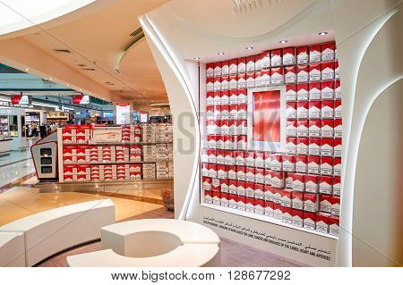 DUBAI, UAE - MARCH 10, 2015: The Dubai duty-free shopping area interior. Dubai International Airport is the primary airport serving Dubai, United Arab Emirates