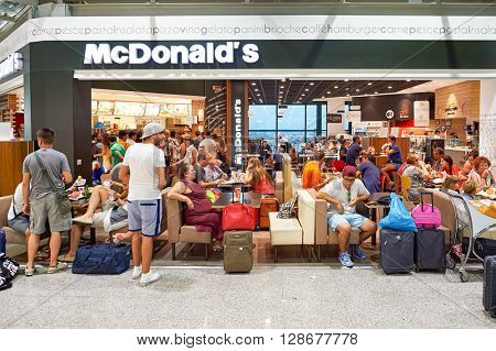 ROME, ITALY - AUGUST 04, 2015: McDonald's in Fiumicino Airport. The McDonald's Corporation is the world's largest chain of hamburger fast food restaurants