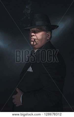 Retro 1930S Gangster Smoking Cigar. Classic Studio Portrait.
