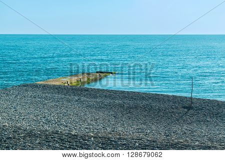 Breakwater and pebble beach with sea views