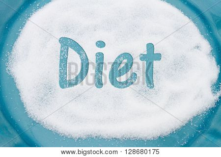 Close-up of Teal Plate with a lot of sugar with text Diet