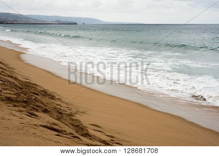 Early morning stunning isolated beach scene before the rain.