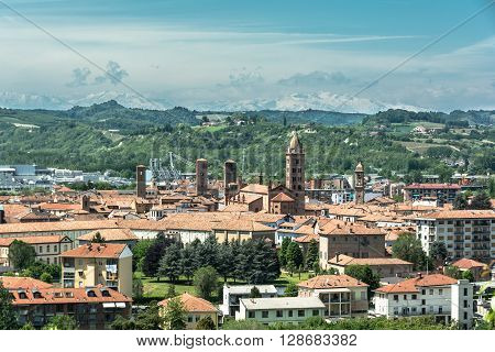 Alba,Piedmont,Italy,Europe - May 3, 2016 : View from above of Alba with hills and mountains in background