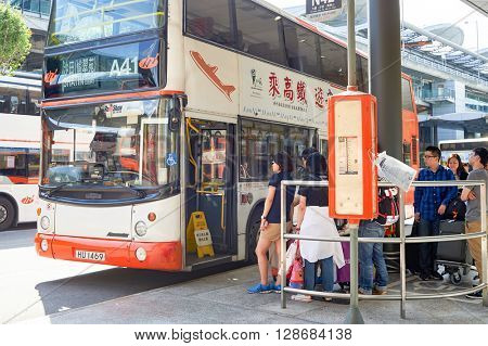 HONG KONG - JUNE 04, 2015: people waiting for boarding at A41 in airport. Hong Kong International Airport is the main airport in Hong Kong. It is located on the island of Chek Lap Kok