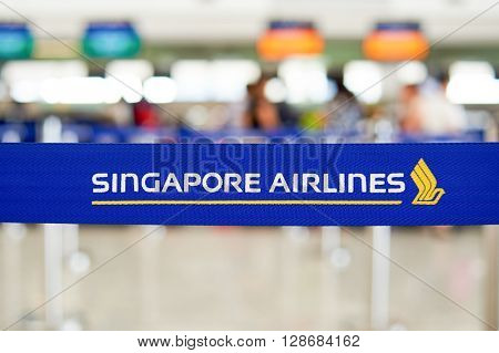 HONG KONG - JUNE 18, 2015: close up shot of belt with logo of Singapore Airlines near check in counters in Hong Kong Airport. Hong Kong International Airport is the main airport in Hong Kong.