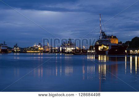 Industrial background, Bergen port night view, Norway