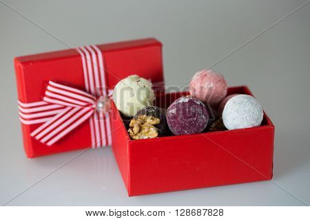 Champagne truffles in a gift in a red box