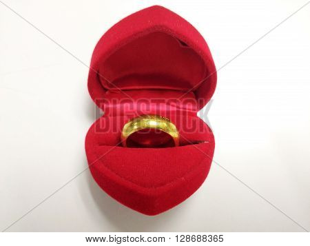 A gold ring in a heart-shaped box gift for Chinese New Year and Valentine's day
