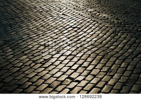 Cobbled street with sunlight