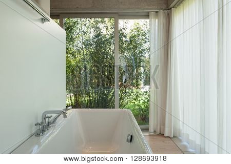 interior of new apartment, modern bathroom, bathtub in the foreground