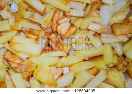 fried with a crust of potatoes sliced closeup