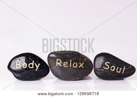 Stone treatment. Black massaging stones isolated on a white background. Hot stones. Balance. Zen like concepts. Basalt stones.
