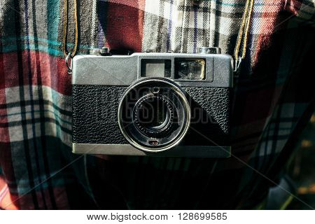 Stylish Analog Photo Camera On Traveler In Sunny Forest In The Mountains