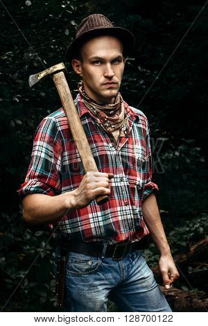 Stylish Hipster Lumberjack With Ax In The Sunny Forest In Mountains