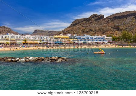 PUERTO DE MOGAN, GRAN CANARIA, SPAIN - APRIL 21, 2016: Bay and the beach area of Puerto de Mogan, a small fishing port on Gran Canaria, Spain. It's called a Little Venice of the Canaries.
