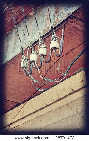 Ceramic insulators on the wall. Connection wiring.