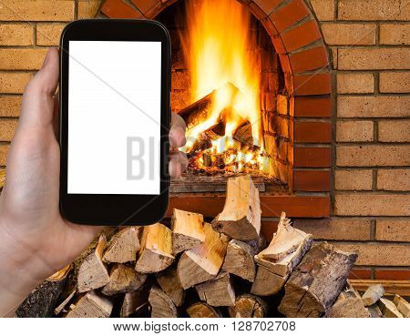 Tourist Photographs Fireplace On Smartphone