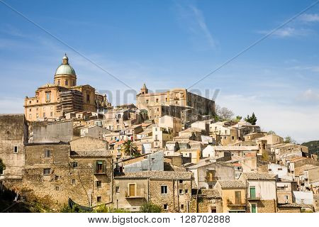The skyline of the hilltop village called Piazza Armerina in the Enna province of central Sicily in Italy