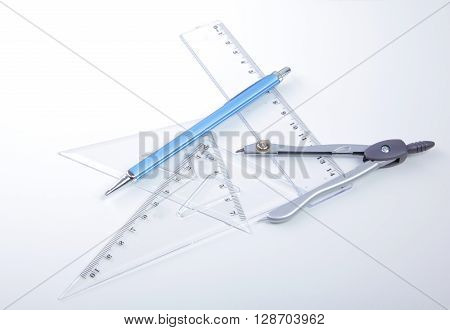 pair of compasses drawing circle on a paper.