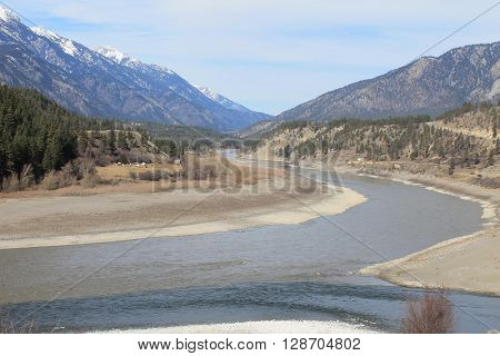 Ranching where the river meet by the mountains