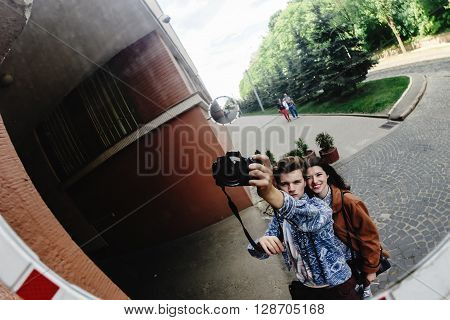 Stylish Happy Hipster Couple Having Fun Laughing And Taking Selfies In The Park In Town In Sunny Spr