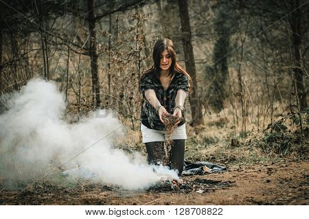 Stylish Beautiful  Brunette Girl In Ethnic Clothes In The Amazing Woods With Fire