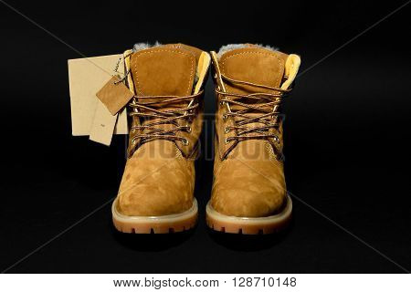 Stylish Yellow Nubuck Mens Boots On Black Background, Advertising Concept