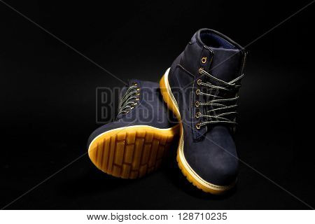 Stylish Blue Nubuck Mens Boots On Black Background, Advertising Concept