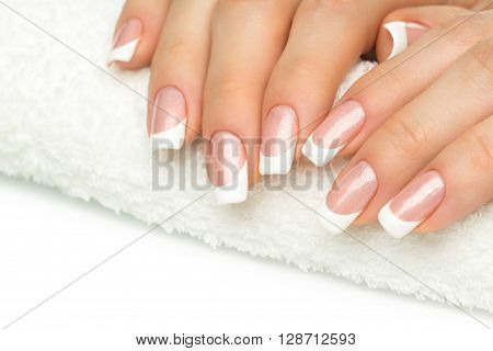 poster of Beautiful Fingers With French Manicure On The Towel. Manicure In A Beauty Salon.