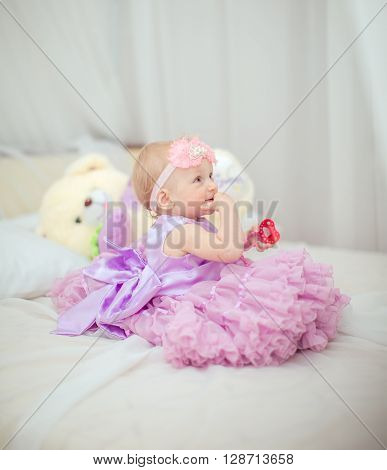 Portrait of little baby girl in lilac dress lilac dress