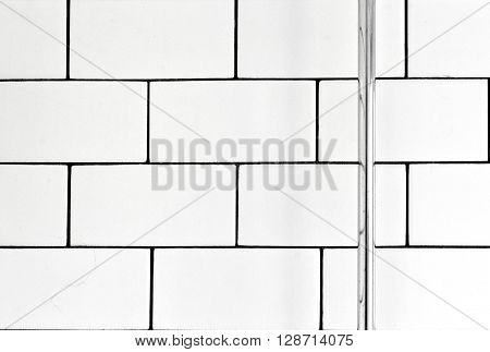 White vintage metro tiles and black grout in a bathroom