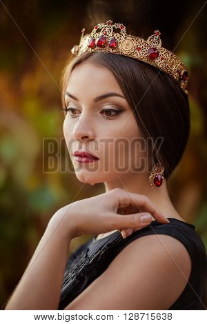Beautiful woman model with professional makeup in jewelry crown