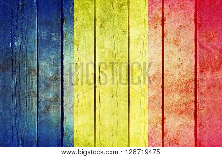 Romania wooden grunge flag. Romania flag painted on the old wooden planks. Vintage retro picture from my collection of flags.