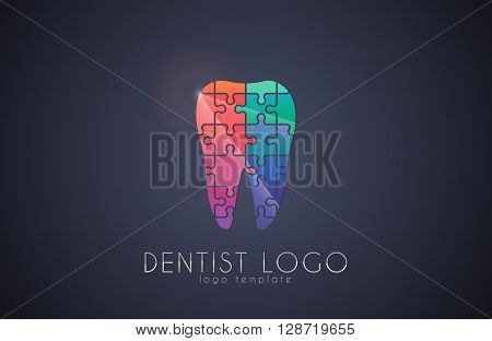 tooth of the puzzle. Dentist logo. Medicine logo design. Color tooth