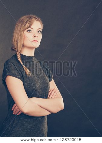 Facial emotions expression. Young blonde expressive angry furious resentful woman. Emotional girl full of anger and bad feelings.